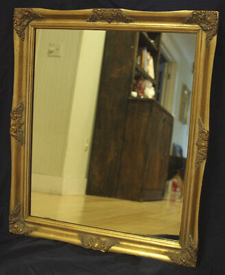 Refinished ornate gold leaf finished corner mirror