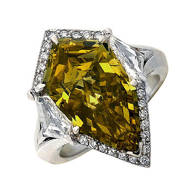 Unique Platinum GIA Certified Fancy Colored 7.94ct Shield Cut Diamond Ring