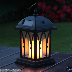 solar powered flickering amber led candle lantern outdoor