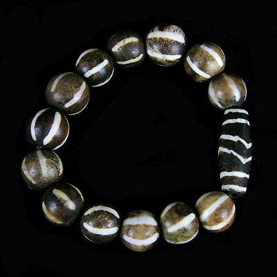 A bracelet comprising round Pumtek beads with a central Pumtek barrel bead y534