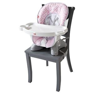 Fisher Price space saver high chair.