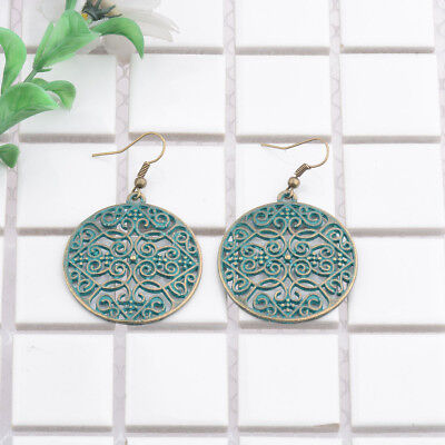 Vintage Women's Copper Green Rust Round Hollow Out Carved Drop Dangle Earrings ()