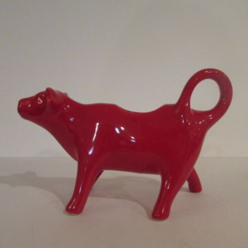 A Glossy Red Cow Creamer Figurine