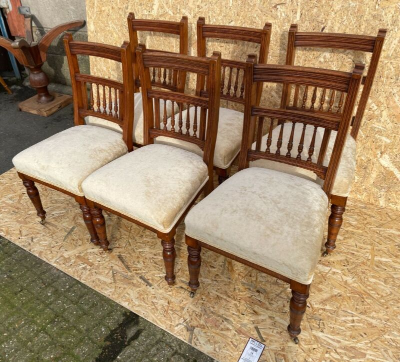 A Set of Six Walnut Victorian Dining Chairs