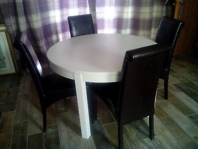 cream extending dining table ( chairs sold seperately )