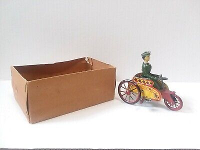 Vintage German Marke Stock  tin wind up  Stock Lady in Three Wheel  Carriage