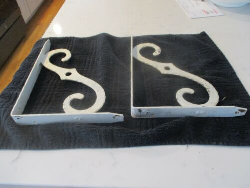 Pair of iron white painted brackets/corbels. Nice design.Vintage
