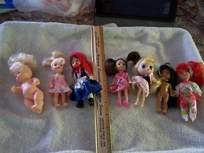 Lot of 7 Small Tiny Short Plastic Dolls Toys