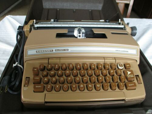 SMITH CORONA CORONET SUPER 12 ELECTRIC TYPEWRITER WITH CASE AND MANUAL