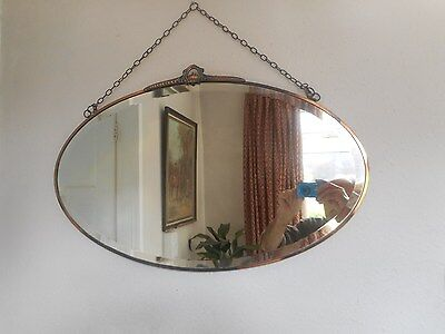 .Art Deco 20s/30s copper framed  oval wall mirror. Period item.