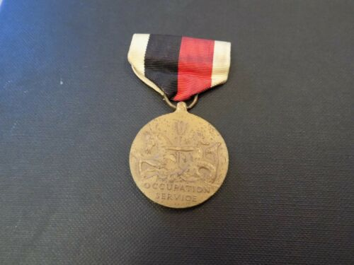 US NAVY CONTEMPORY WW2 OCCUPATION MEDAL - NEEDSA CLEAN SHOWS SIGNS OF ITS AGE