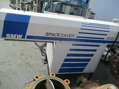 December 1997 Smwsameca Swiss Made Spacesaver 2000 Bar Feederas-described