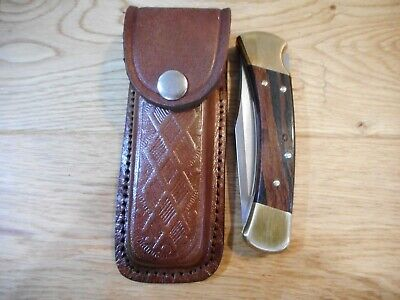 Brown textured leather knife sheath. Holds a Buck 110.  Five inch.  Chrome Snap  Chrome Leather Knife