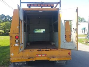 Enclosed Utility service tool bed with ladder rack