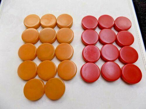 "26 VINTAGE BUTTERSCOTCH & RED BAKELITE CHECKERS: 1 & 1/4""D X 1/4""W."