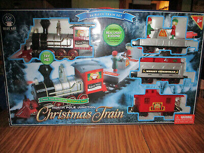 BLUE HAT NORTH POLE JUNCTION CHRISTMAS TRAIN 34 PIECE SET LIGHT AND SOUND