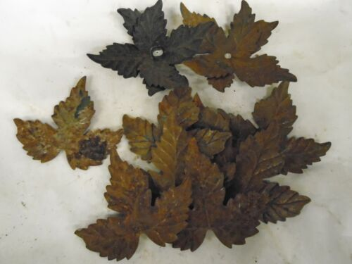 ANTIQUE PRESSED STEEL LEAFS APPROX 20 OFF