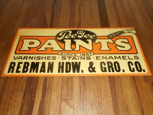 PEE GEE PAINTS & Varnishes REBMAN HARDWARE & Grocery Co Advertising SIGN