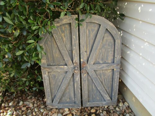 Pair of distressed gray vintage inspired round top barn doors with hardware