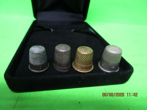 Set of 4 antique thimbles 7,8,9? &10 one is hallmarked