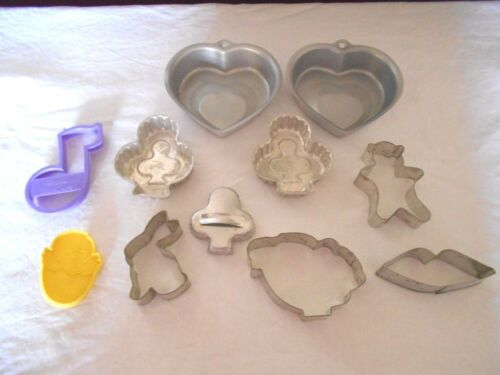 10 VINTAGE  COOKIE CUTTERS  AND MOLDS