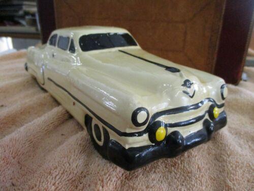 """Vintage 1954 Cadillac ceramic still bank 10 3/4"""" long carnival chalkware?"""