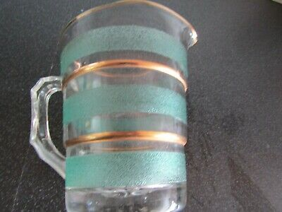 A  vintage retro sugar glass jug - green