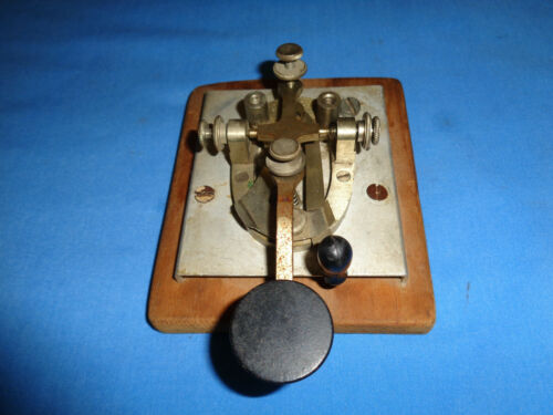 Vintage J.H. Bunnell Telegraph Key Mounted on a Wood Board.