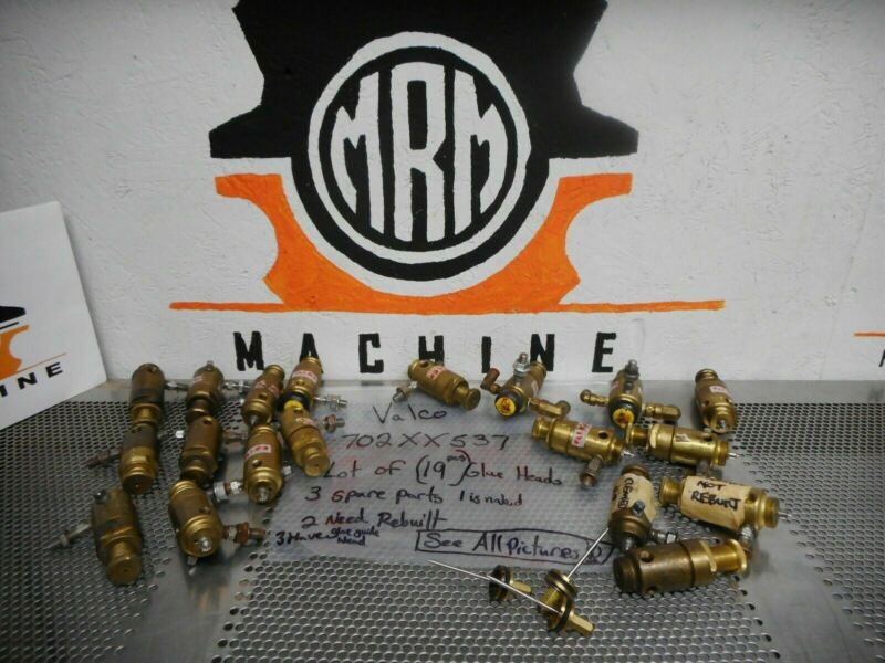 Valco 702XX537 (19) Glue Gun Heads & (3) Spare Parts (2 Of The 19 Need Rebuilt)