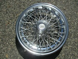 one 1986 to 1995 Chevy Caprice 15 inch locking wire spoke hubcap wheel cover