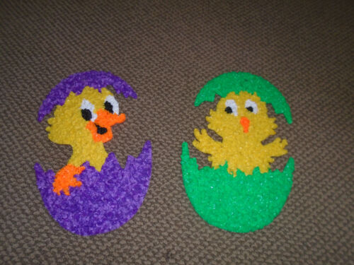 2  Melted plastic popcorn decorations-chick/duck in eggs