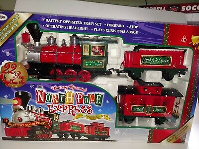 North Pole Express Train Set Battery Operated 22 Piece Set Around Christmas Tree