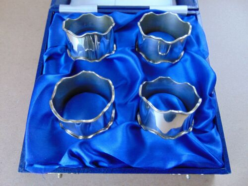 EXCELLENT SET OF 4 STERLING SILVER WAVY RIM NAPKIN RINGS 1991