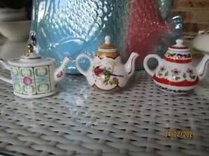 Miniature porcelain teapots approx 7cm high $10ec or 3/$25/ or 6/$35