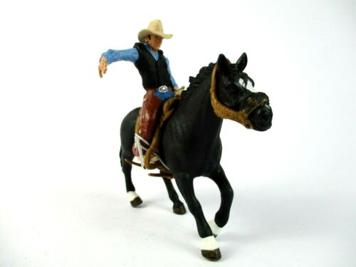 Schleich Saddle Bronco Riding with Cowboy