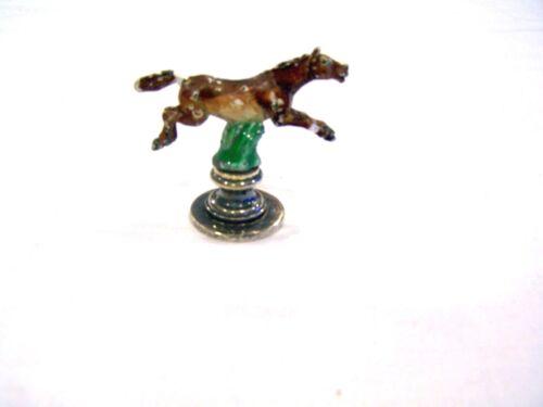"Gucci silver horse figure, 1.5"" tall"