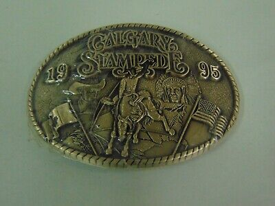1995 CALGARY STAMPEDE SOLID BBRASS RODEO BUCKLE NEW IN SHRINK
