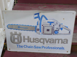 Husqvarna The Chain Saw Professionals Embossed Aluminum Sign