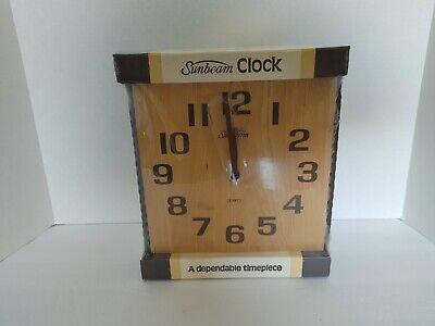 "Sunbeam Quartz Wall Clock Wood Trim 9""x9"" new in unopened packaging"