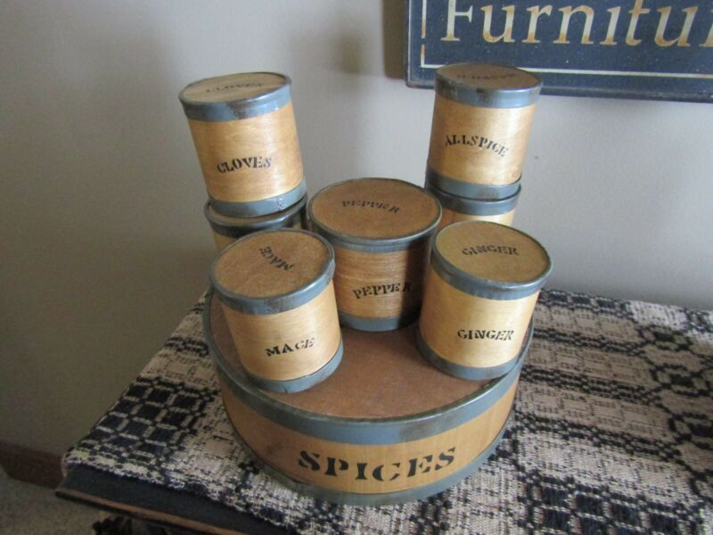 ROUND WOOD SPICE BOX WITH 7 ROUND SPICE CONTAINERS INSIDE WITH NAMES OF SPICES