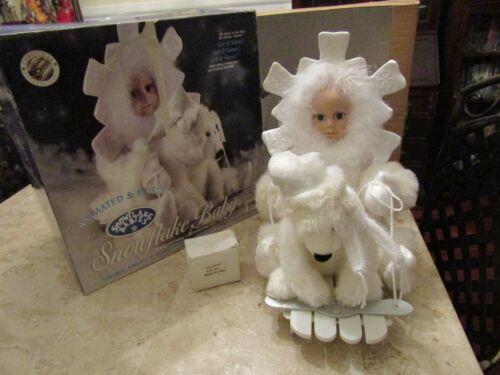 "Christmas International Animated & Musical Snowflake Baby- Sings ""Let it Snow"""