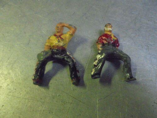 Vintage Two Metal Soldiers Cowboys