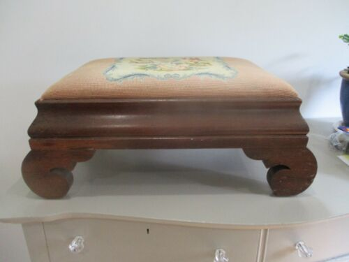 Antique empire style large footstool. Needlepoint top.