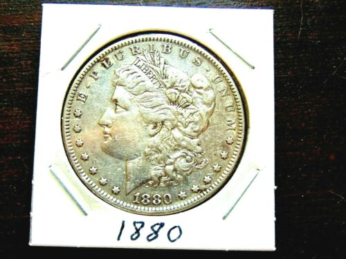 1880 Morgan Silver Dollar. Fine. 90% silver.  Additional coins ship Free.  Nic.
