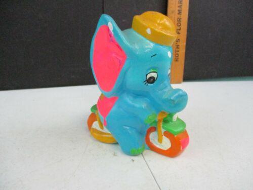 Vintage Chalkware Elephant Riding Bicycle Bank