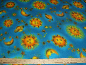 fleece fabric celestial man in the moon and stars on blue bty