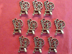 Tibetan-silver-spinning-wheel-charm-pack-of-10-fairytale-themes