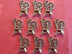 Tibetan silver spinning wheel charm pack of 10 - fairytale themes