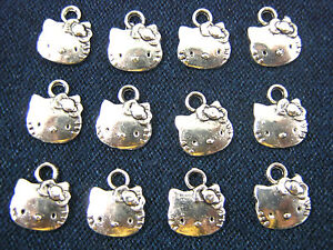 12 x Tibetan Silver Hello Kitty Face Charms for Necklaces Bracelets, Jewellery.