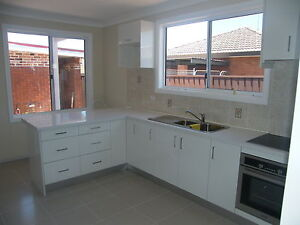 COMPLETE-NEW-KITCHEN-WITH-STONE-BENCHTOP